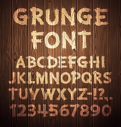 Grunge letters and numbers on wooden background vector