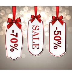 White paper sale labels with red satin bows vector