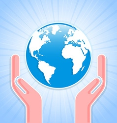 Caring hands with planet earth vector