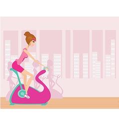 Indoor cycling - girls cycling at gym vector