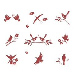 Silhouettes of birds on branches vector