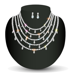 Necklace and earrings with white precious stones vector