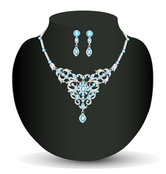 Necklace and earrings with blue jewels vector