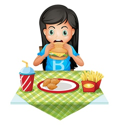 A hungry girl eating at a fastfood restaurant vector