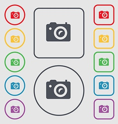 Digital photo camera icon sign symbol on the round vector