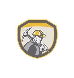 Coal miner hardhat holding pick axe shield retro vector