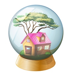 A crystal ball with a pink house inside vector