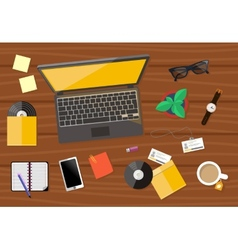 Top view of workplace with laptop and devices vector