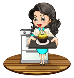 A woman baking a cupcake vector