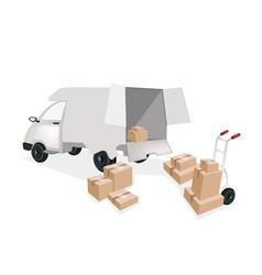 Hand truck loading corrugated cardboard into a van vector