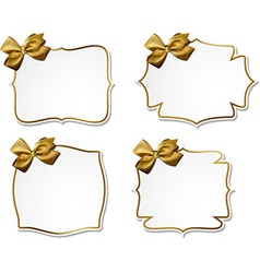 White paper gift cards with golden satin bows vector