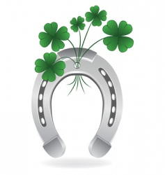 Horseshoe and four leaf clover vector