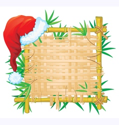 Bamboo frame with santa hat vector