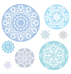 A collection of snowflakes on a white background vector