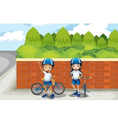 Two young bikers at the street vector
