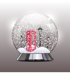 Snow globe with a red telephone booth and lantern vector