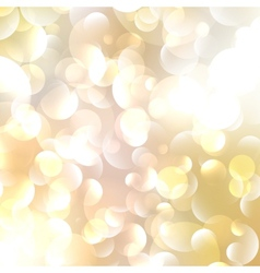 Gold colored abstract lights background vector