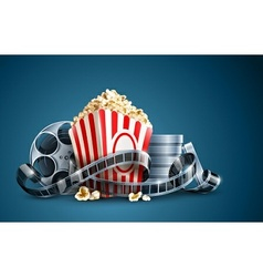 Movie film reel and popcorn vector