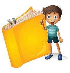 A smiling boy and a yellow book vector