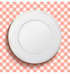 White classic plate on red checkered tablecloth vector