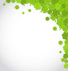 Greeting background with shamrocks for st patricks vector