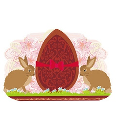 Chocolate egg with red bow and two beautiful vector