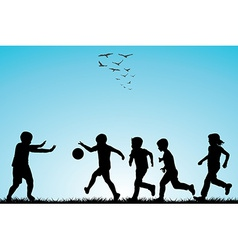 Children silhouettes playing football vector