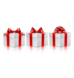 Three white gift boxes with a red bows vector