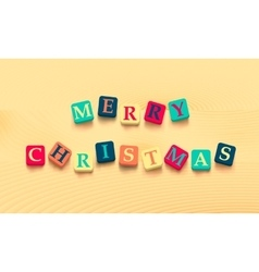 Words merry christmas with colorful blocks vector