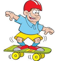 Cartoon boy riding a skate board vector