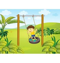 A little boy swinging vector