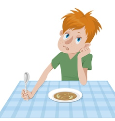 Boy eating at a table vector