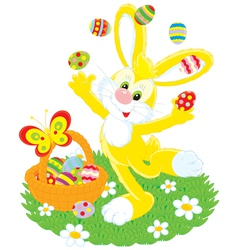 Easter bunny juggles painted eggs vector