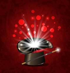 Magician hat wand and magical glow vector