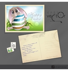 Easter bunny with colorful egg vector