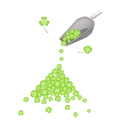 A metal shovel with four leaf clovers vector