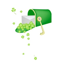 A letter and four leaf clovers in mailbox vector