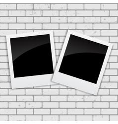 Instant photos on grunge brick background vector