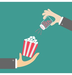 Popcorn businessman hand salt shacker vector