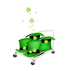 Hand truck loading four beautiful green hats vector