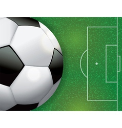 Soccer ball on grass textured field vector