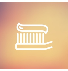 Toothbrush with toothpaste thin line icon vector