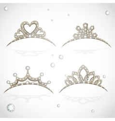 Shining gold tiaras with diamonds vector