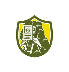 Photographer shooting vintage camera shield retro vector