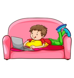 A boy using a laptop at the sofa vector