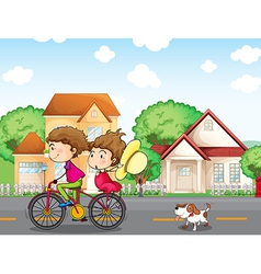 A boy and a girl biking followed by a dog vector