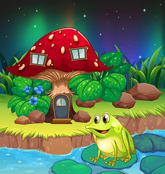 A frog near the giant red mushroom house vector