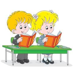 Schoolchildren read at a lesson vector