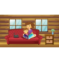 A mother reading with her daughter at the sofa vector