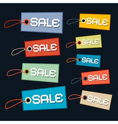 Sale tags - labels set with strings on dark vector
